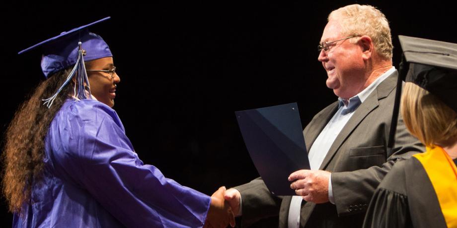 student receiving certificste