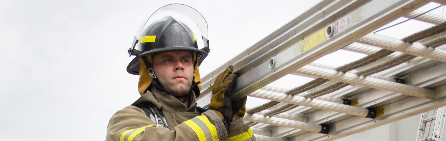 Fire Academy Student with Ladder